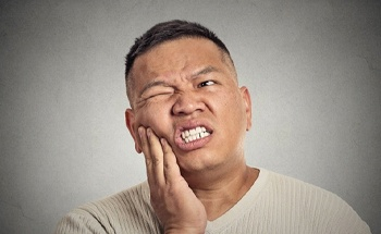 pained man needs to see his San Antonio emergency dentist