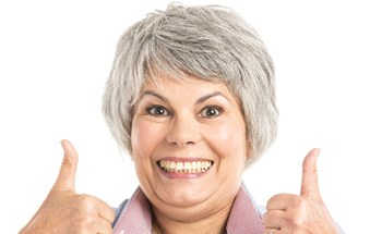 older woman giving thumbs up