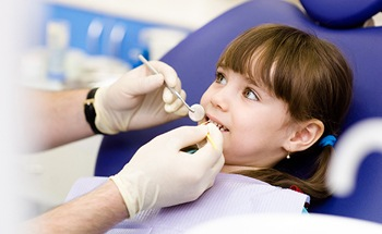 Young girl receiving dental treatment