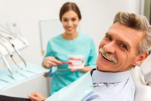 Man at initial consultation for dental implants in San Antonio