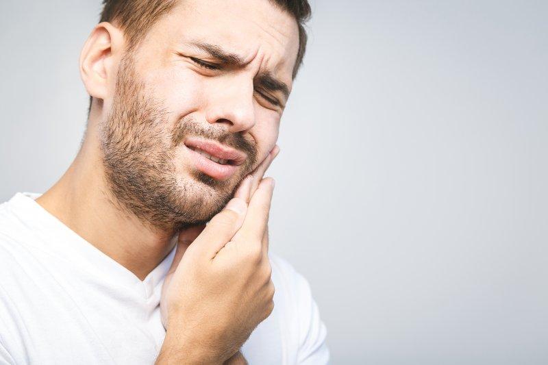 Man experiencing dental emergency