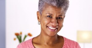 Woman who replaced her missing teeth with dental implants